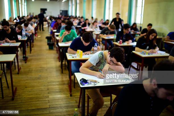 High school students sit behind desks during a philosophy exam the first test session of the 2015 baccalaureate on June 17 2015 in Paris Some 684734...
