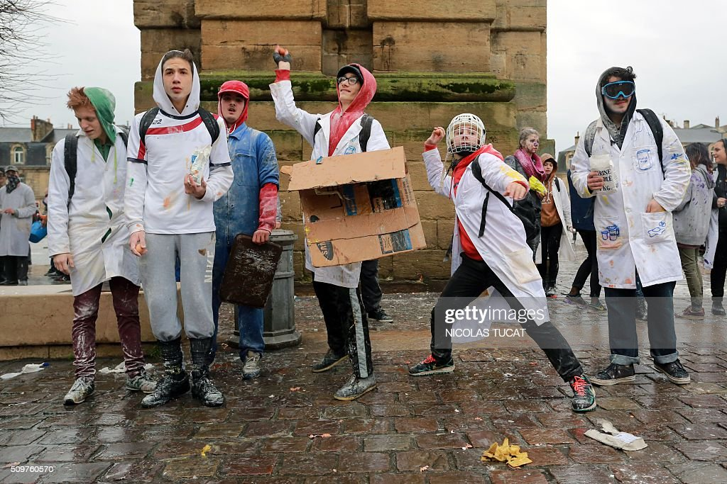 High school students take part in the 'Pere Cent' in Bordeaux, western France, on February 12, 2016. During the traditional 'Pere Cent', held in southwestern French cities hundred days before the baccalaureate exam, students from different high schools battle using flour, eggs and tomato sauce. TUCAT