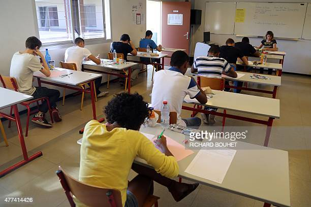 High school students take the philosophy exam the first test session of the 2015 baccalaureate on June 17 2015 in La Possession on the western part...