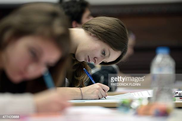 High school students take the philosophy exam the first test session of the 2015 baccalaureate on June 17 at the Fustel de Coulanges high school in...