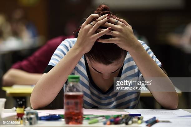 High school students take the philosophy exam the first test session of the 2016 baccalaureate on June 15 2016 at the Fustel de Coulanges high school...