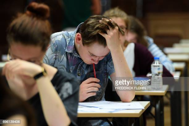 High school students take the philosophy exam the first test session of the 2017 baccalaureate on June 15 2017 at the Fustel de Coulanges high school...