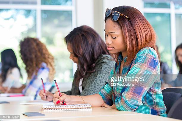 High school students taking test while sitting at desks