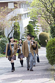 High School Students Walking on Street Together