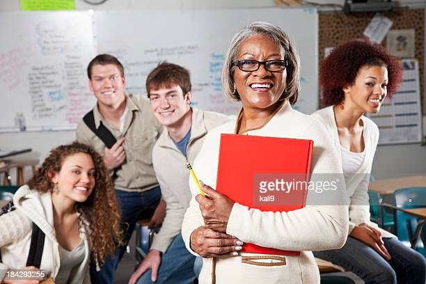High school teacher with students in class