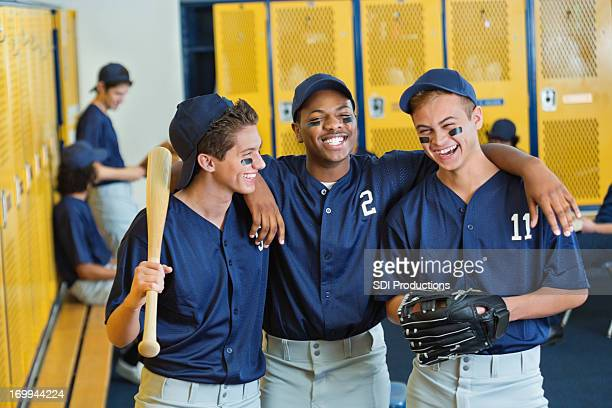 High school teammates in locker room after baseball game