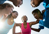 High School Track Coach Motivating Student Athletes in Huddle
