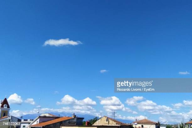 High Section Of Houses Against Blue Sky