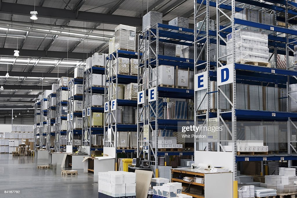 High shelving units in Warehouse. : Stock Photo