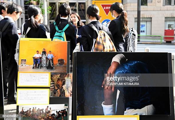 High shool students listen to a member of Amnesty International talk about the situation in Aleppo Syria at the campus of the Meiji University in...