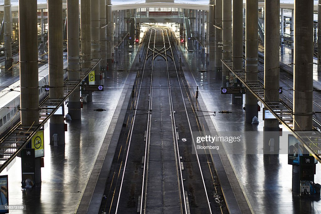 High speed rail tracks are seen between empty platforms at Atocha railway station on the morning of a general strike in Madrid, Spain, on Wednesday, Nov. 14, 2012. Spanish unions today staged their second general strike against Prime Minister Mariano Rajoy as mounting opposition to budget cuts and bank bailouts undermines the 11-month-old government's ability to repair the economy. Photographer: Angel Navarrete/Bloomberg via Getty Images