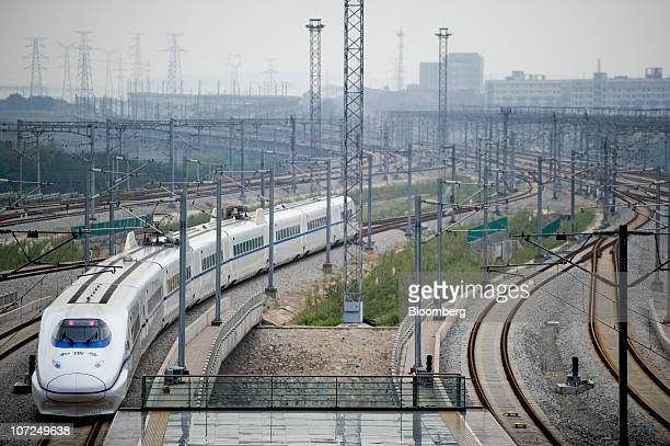 A high speed train leaves the Wuhan Railway Station in Wuhan China on Wednesday Sept 29 2010 China is constructing a high speed rail network between...