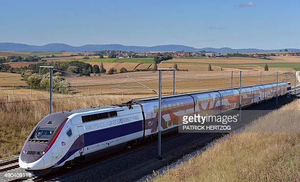 A TGV high speed train passes on the EastEuropean LGV line during a test on September 28 2016 in Gougenheim eastern France 106 kms of new track have...