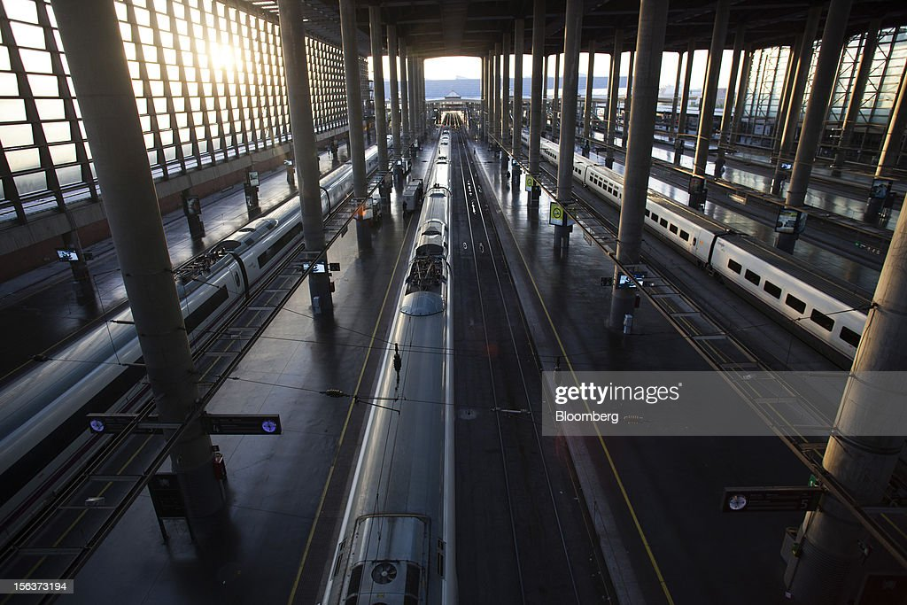 High speed trains stand between empty platforms at Atocha railway station on the morning of a general strike in Madrid, Spain, on Wednesday, Nov. 14, 2012. Spanish unions today staged their second general strike against Prime Minister Mariano Rajoy as mounting opposition to budget cuts and bank bailouts undermines the 11-month-old government's ability to repair the economy. Photographer: Angel Navarrete/Bloomberg via Getty Images