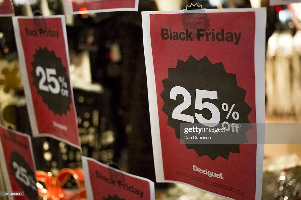 A high street clothing chain entices shoppers with a pre-Christmas sale on November 29, 2013 in London, United Kingdom. Though traditionally a US phenomenon, 'Black friday' sales appear to have taken hold in the UK with many retailers offering large discounts for one day only, mimicking the behaviour of their American counterparts.