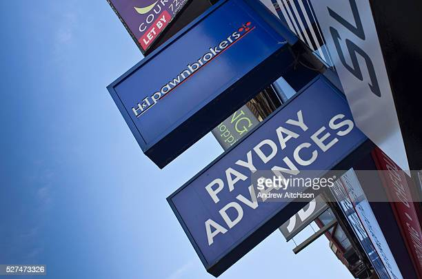 High street signs for the cash loans payday advances and pawnbroker shops in Dalston London UK These shops are common on the high street