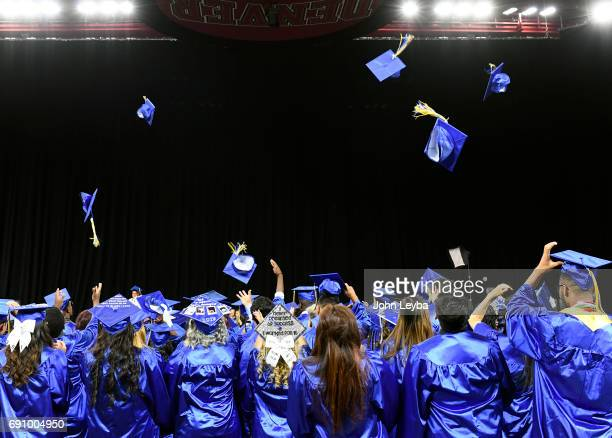 High Tech Early College students throw their hats in the air after graduating on May 31 2017 There were 105 grads receiving their diplomas