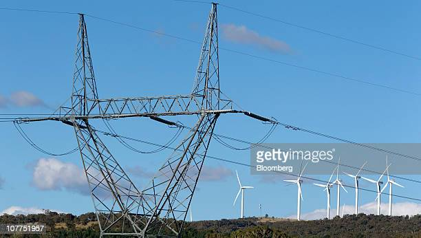 High tension power lines stand near the wind turbines operating on Capital Wind Farm in Bungendore Australia on Wednesday Dec 22 2010 The wind farm...