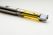 High THC Potency Cannabis Oil Vape Pen Isolated on a White Background
