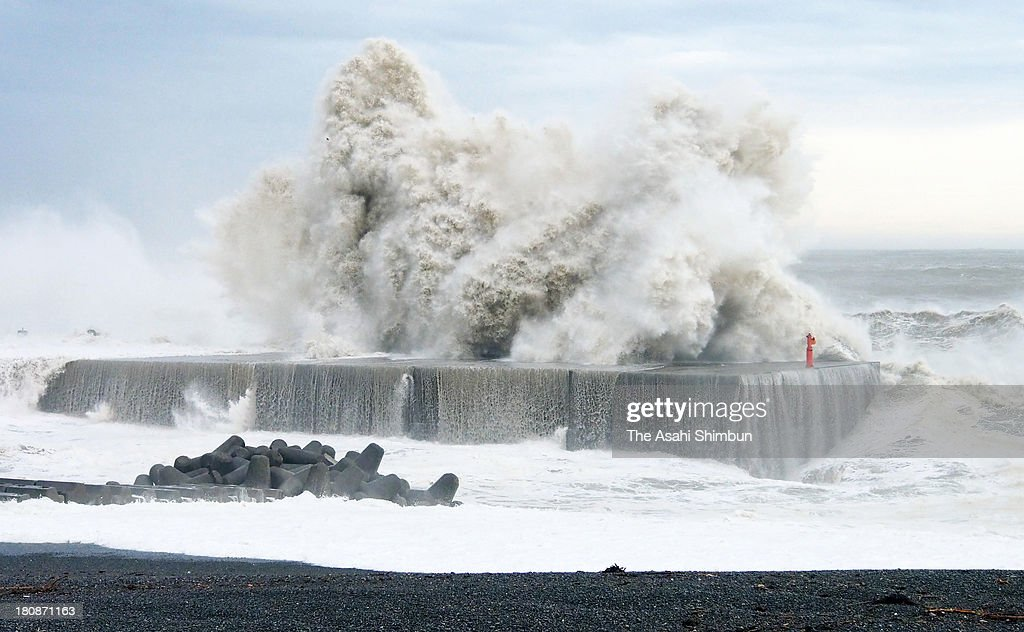 High tide batters at breakwaters triggered by typhoon Man-Yi approaching on September 16, 2013 in Kumano, Mie, Japan. The storm hit land near Toyohashi, Aichi Prefecture, before 8 a.m. and moved along Honshu throughout the day, damaging buildings, disrupting transportation and causing blackouts, three killed and five missing.