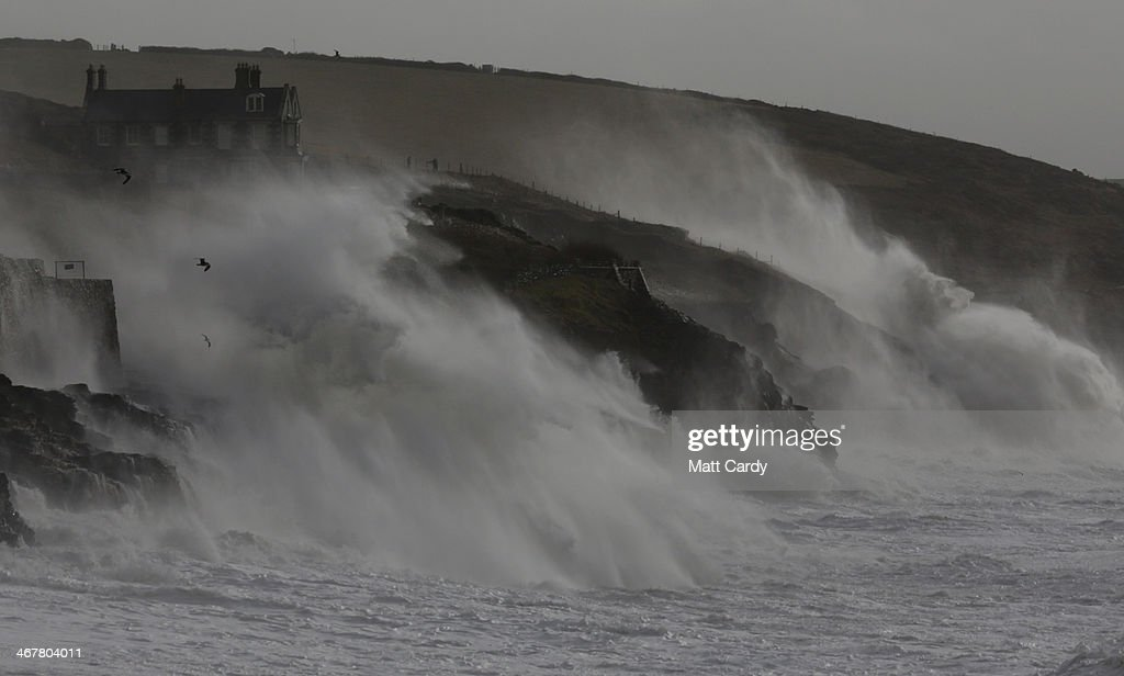 High tide storm waves break at Porthleven on February 8 2014 in Cornwall England The UK is bracing itself for more storms and spells of rain over the...