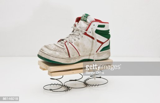 A high top sneaker on a homemade spring