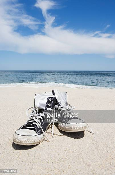 High top sneakers on beach