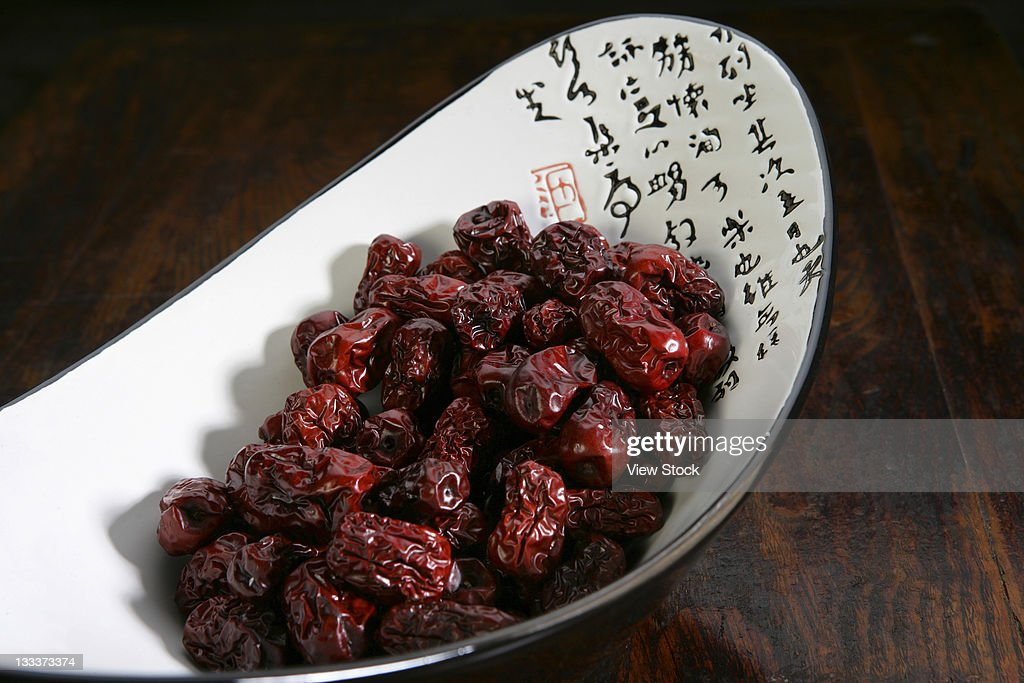 high view of a bowl of dried dates : Stock Photo