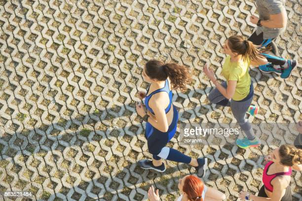 High view of people jogging