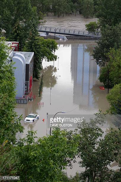 A high view of the flooded Bow River shows a closed bridge and water covered an island next to the downtown core in Calgary Alberta Canada June 22...