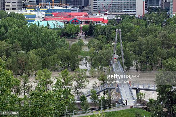 A high view of the flooding at Bow River shows a closed bridge and water covered an island next to the downtown core in Calgary Alberta Canada June...