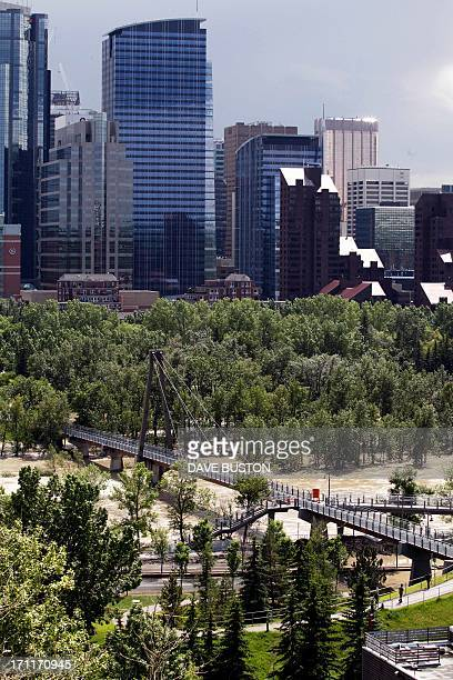 A high view of the flooding at Bow River shows a closed footbridge to an island in Calgary Alberta Canada on June 22 2013 Water levels have dropped...