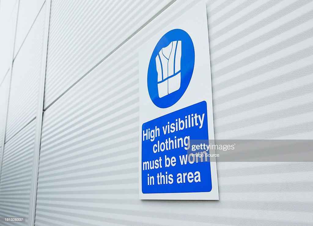 High visibility clothing sign on warehouse door