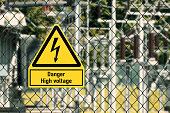 Electrical hazard sign placed on a fence of an electrical substation