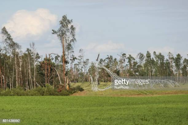 High voltage energy pole twisted by the wind is seen in the Nakla village northern Poland on 14 August 2017 Storms which on Friday 11th August night...