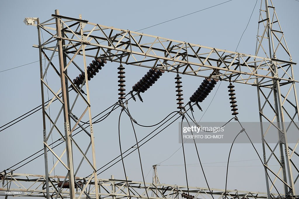 High voltage lines connect at a electricity sub station in the Northwestern Indian city of Amritsar on May 16, 2013. India, which has one of the largest integrated electricity grids in the world is challenged by peak electricity demands from consumers in the summer months of June and July when the temperatures hover at around 48 Degrees Celcius. AFP PHOTO/ROBERTO SCHMIDT