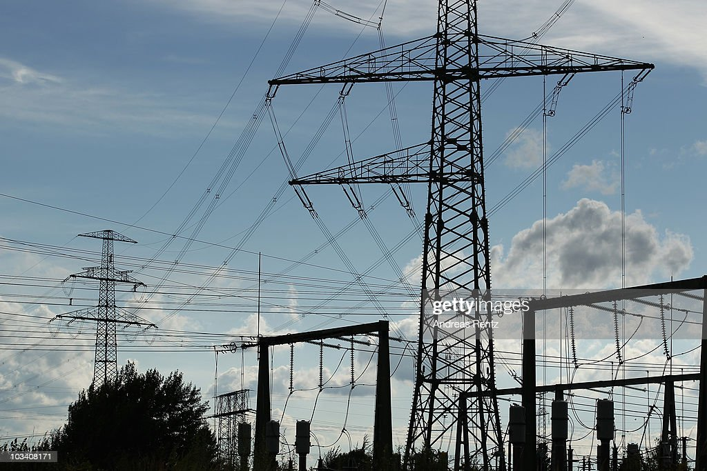 A high voltage power line tower stands near a transformer station on August 16 2010 in Altlandsberg near Berlin Germany Higher energy prices drove...