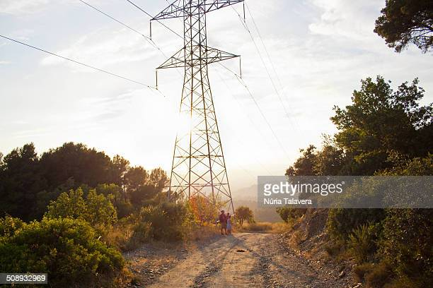 High voltage tower on a mountain path