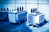 High voltage transformer with electrical insulation and electrical equipment in power substation.