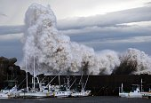 High waves batter a breakwater at a port at Kihou town in Mie prefecture central Japan on October 6 2014 Strong typhoon Phanfone slammed into Japan...