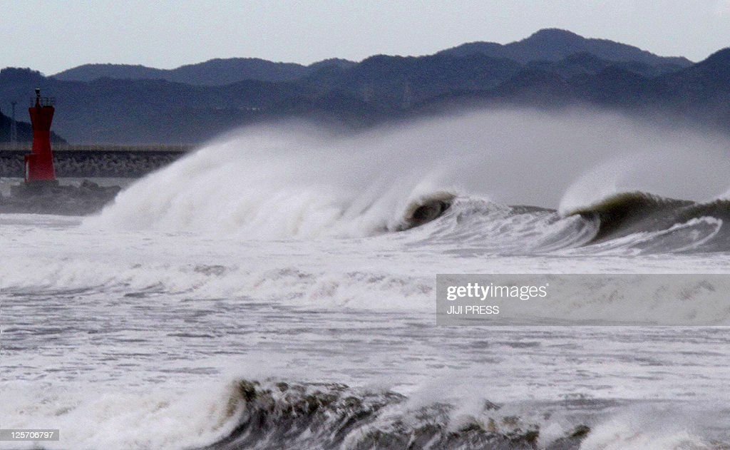 High waves batter a breakwater at Komatsu beach in the city of Tokushima, Tokushima prefecture, in western Japan on September 21, 2011. Powerful Typhoon Roke smashed into disaster-ravaged Japan, having already killed at least four people, less than a month after a vicious storm left 100 dead.