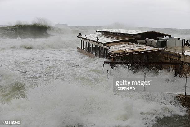 High waves from rough seas cover a restaurant on the seafront of the historical Lebanese city of Byblos north of Beirut on January 7 2015 The fierce...