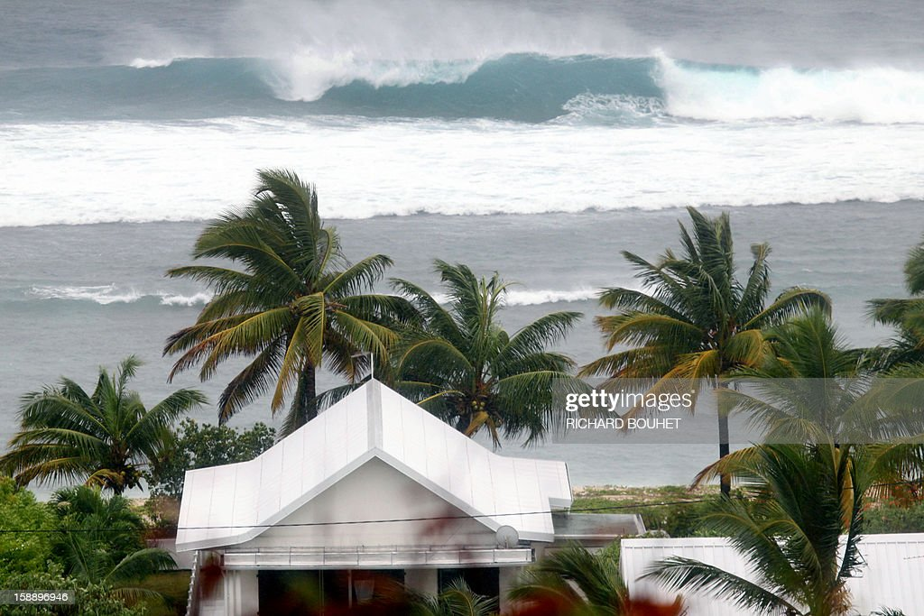 High waves hit the coastline on January 3, 2013 in Saint Gilles, western part of French overseas' island of La Reunion, as cyclone Dumile approaches and authorities declare today a red alert that forbid people to leave their homes.