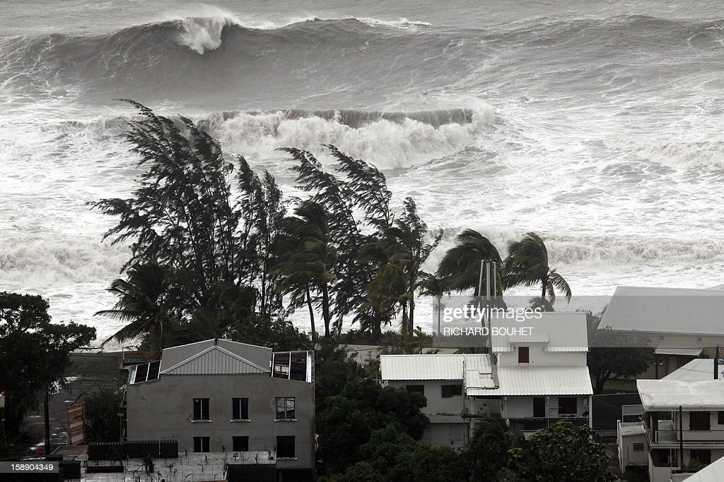 High waves hit the coastline on January 3, 2013 in Saint-Paul, western part of French overseas' island of La Reunion, as cyclone Dumile lashed Reunion. Winds of up to 180 kilometres per hour (110 miles per hour) and torrential rain caused extensive damage to the electricity network after cyclone Dumile passed within 90 kilometres of the island's west coast at around 0900 GMT. AFP PHOTO / RICHARD BOUHET
