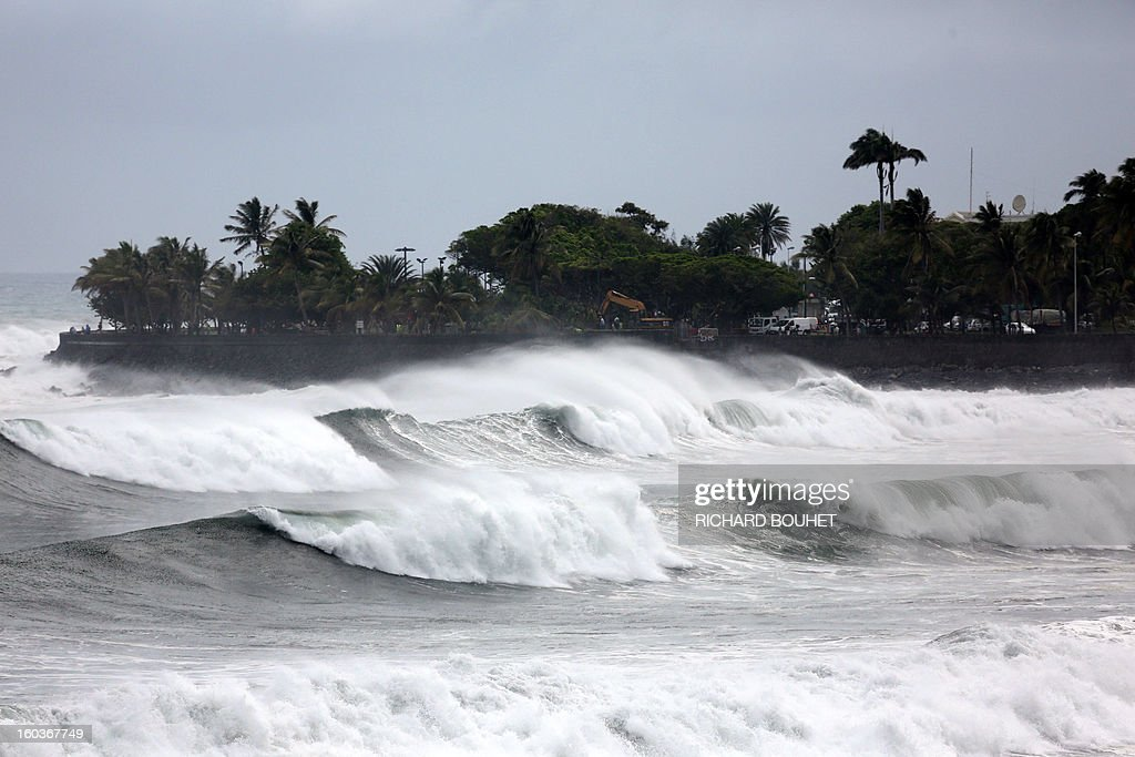 High waves hit the coastline on the North coast of French Indian Ocean island of La Reunion on January 30, 2013 near Saint-Denis. The cyclone Felleng was announced at 735 Km north of the island and progresses at the speed of 17 Km per hour. Felleng should approach the coast of the island from 300 km on February 1st. AFP PHOTO RICHARD BOUHET