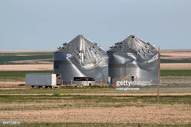 High wind damaged granaries Colorado plains farm