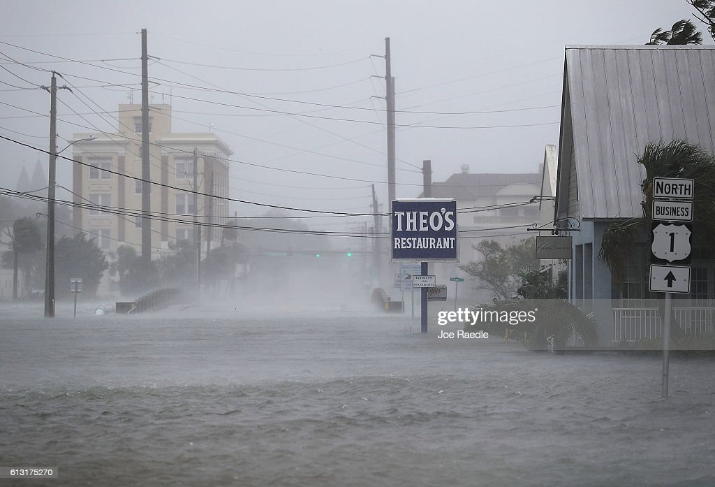 High winds stir up a flooded street as Hurricane Matthew passes through the area on October 7 2016 in St Augustine Florida Florida Georgia South...