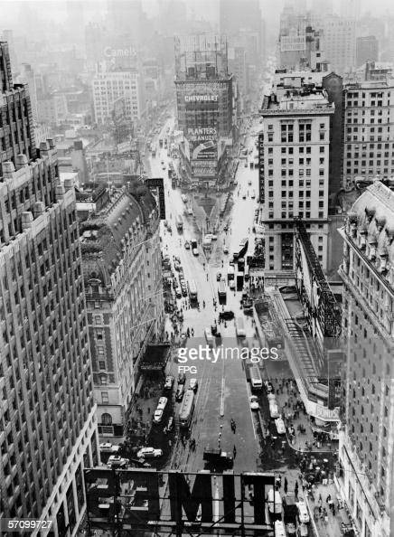 Highangle view looking north of rainy Times Square from the top of the Times Tower at the intersection of Broadway and Seventh Avenue at 42nd Street...