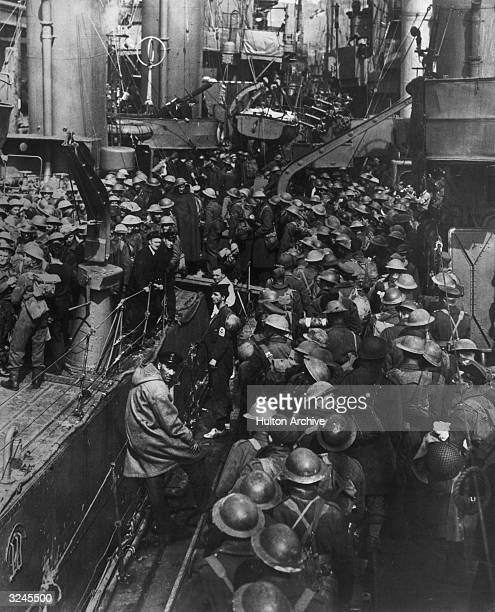 Highangle view of a crowd of uniformed Allied soldiers standing on a ship during the evacuation of British and French troops from Dunkirk