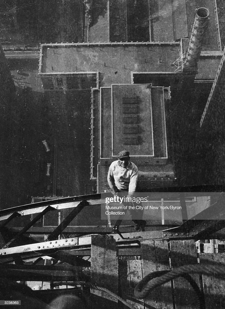 High-angle view of a worker sitting on a steel girder high atop the Chrysler Building, on the 54th floor, during its construction, New York City.